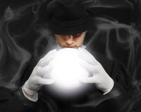 Magic, performance, circus, show concept. Soft focus. Magician in top hat showing trick. Magic, performance, circus, show concept. Soft focus Stock Photos