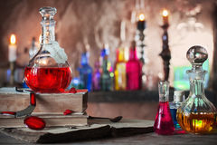 Magic potion, ancient books, candles Stock Image