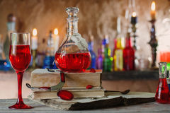 Magic potion, ancient books, candles Royalty Free Stock Photo