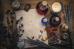 Magic potion and blank recipe scroll. Phytotherapy. Alternative herbal medicine. Shaman. Druidism. Magic potion ancient recipe scroll with copy space Royalty Free Stock Images