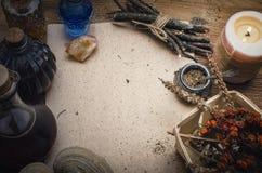 Magic potion and blank recipe scroll. Phytotherapy. Alternative herbal medicine. Shaman. Druidism. Magic potion ancient recipe scroll with copy space Stock Photos
