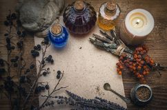 Magic potion and blank recipe scroll. Phytotherapy. Alternative herbal medicine. Shaman. Druidism. Magic potion ancient recipe scroll with copy space Stock Photography