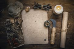 Magic potion and blank recipe scroll. Phytotherapy. Alternative herbal medicine. Shaman. Druidism. Magic potion ancient recipe scroll with copy space Stock Image