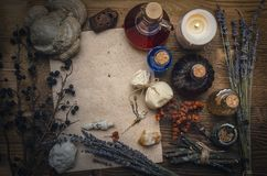 Magic potion and blank recipe scroll. Phytotherapy. Alternative herbal medicine. Shaman. Druidism. Magic potion ancient recipe scroll with copy space Royalty Free Stock Image