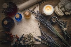 Magic potion and blank recipe scroll. Phytotherapy. Alternative herbal medicine. Shaman. Druidism. Magic potion ancient recipe scroll with copy space stock images