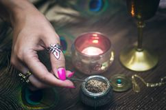 Magic potion. Witchcraft. Magic qure. Shaman. Witch prepares a magic potion. Fortune teller table. Divination. Witchcraft Stock Images