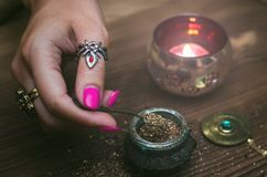 Magic potion. Witchcraft. Magic qure. Shaman. Witch prepares a magic potion. Fortune teller table. Divination. Witchcraft Royalty Free Stock Images