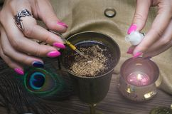 Magic potion. Witchcraft. Magic qure. Shaman. Witch prepares a magic potion. Fortune teller table. Divination. Witchcraft Royalty Free Stock Photo