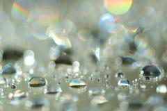 Magic rain. Water drops on a glass Stock Photography