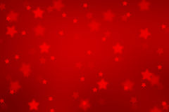 Magic red colored blurred star shape Xmas background Royalty Free Stock Photos
