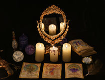 Magic ritual with the Tarot cards, mirrow and crystals Stock Photos