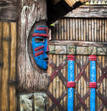 Wooden pagan mask. Magic rituals and pagan idol of ethnic culture  of Africa. natives mask on a wooden post. Native hut decorated talisman - tribal mask of the Royalty Free Stock Images
