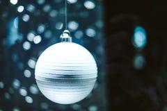 Magic round globes Shining for Christmas. Magic Christmas globes with rays of illuminated round bokeh shining for the upcoming Christmas and New year winter Stock Photos