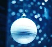 Magic round globes shining for Christmas. Magic Christmas globes with rays of illuminated round bokeh shining for the upcoming Christmas and New year winter Stock Images