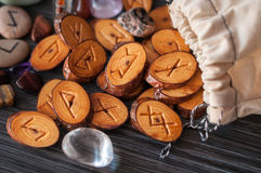 Magic runes. On a dark background from the rag bag spilled a few wooden runes Stock Images