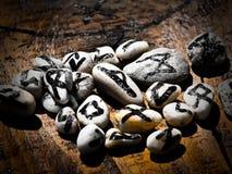 Magic runes of destiny. Group of ancient magic stones with symbols - runes on wood Stock Photos
