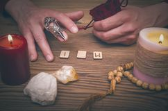 Magic runes for future reading and divination. Runestone reading. Runestone reading. Scandinavian runes divination. Future reading Stock Photo