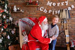 Magic Santa Claus and little boy fooling around and have fun tog Stock Images