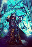 Magic shaman. Portrait of a male shaman in ethnic dress on a background of a futuristic exterior. Fantasy concept, magic Stock Images