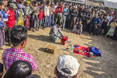 Magic show. A magic show on a market near Loikaw, Myanmar. People are standing in a circle to watch the performance Stock Image