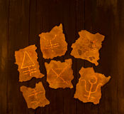 Magic signs on wood in the dark Stock Photo
