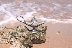 Magic silver lamp on a sea Royalty Free Stock Photography