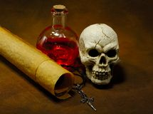 Magic Spells. Photo of Parchments, Skull and a Potion Bottle - Magic Spell Concept Royalty Free Stock Images