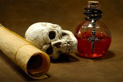 Magic Spells. Photo of Parchments, Skull and a Potion Bottle - Magic Spell Concept Stock Photography