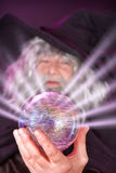 Magic sphere. Evil wizard looking into his magic sphere Royalty Free Stock Photos