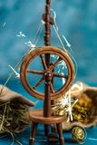 Magic spinning wheel spin straw to gold. Whith sparkles from grimm`s fairy tale Rumpelstiltskin stock image