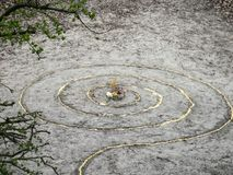 Magic spiral works wicca altar. Pagan religion. Millet on sand Stock Photo