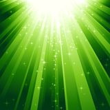 Magic stars descending on beams of light. Festive square abstract background with stars descending on rays of green light. 7 global colors, background controlled Stock Photos