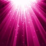 Magic stars descending on beams of light Stock Image