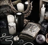 Magic still life with the Tarot cards, mirrow and burning candles Royalty Free Stock Photography