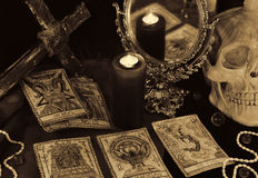 Magic still life with the Tarot cards, mirrow and skull in sepia tone Stock Photos