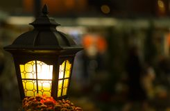 Magic street lamp close-up with copyspace. Warm lantern light on a background Royalty Free Stock Images