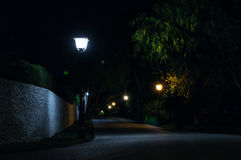Magic street night. Colorful magical dark street iluminated with streetlights Royalty Free Stock Photos