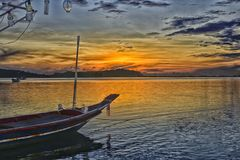 Chaweng Beach, Island of Samui, Thailand. Magic Sunrise and typical boat by the beach of Chaweng, in the beautiful Koh Island Samui stock image