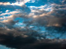 Magic sunset. Beautiful dark clouds at sunset after a thunderstorm. Dramatic and mysterious sky stock image