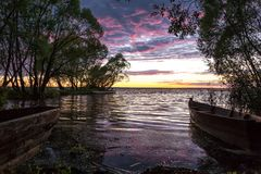 Magic sunset with boats Stock Images