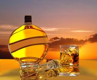 Magic sunset, sunrise in bottle & glass of wiskey. stock images