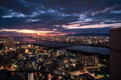 Magic Sunset View from Umeda Sky Building in Osaka, Japan. High angle view of Osaka City with bridges over Yodo River from the top of Umeda Sky Building with a royalty free stock image