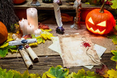 Magic table with old scrollami in the witch's cottage Stock Image