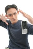 Magic of technology. Man with gesture magic on mobile phone Royalty Free Stock Images