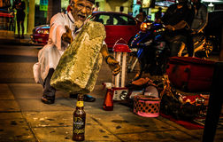 Magic! Is it ? Traditional Medicine man. Night photo of an aged man in Bukit bintang street in Kuala lumpur. This man selling some traditional medicine, he put a Stock Photo