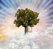 Magic Tree. View of a fantastic tree in the sky with a flowered swing
