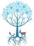 Magic tree with animals and snowflakes Stock Photos