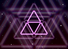 Magic triangle symbol spreads the shiny mystic energy in spiritual space Stock Images