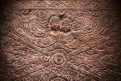 Magic two ghost on carved wall relief inside the 6th century temples in Aihole, India. Ancient Indian artwork. Stock Image