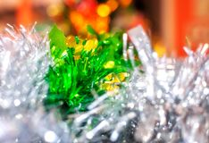 Magic vintage holiday glitter background with blinking Christmas lights. Colorful Christmas decorations in selective focus on a Christmas bokeh lights blurred Stock Images
